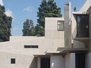 Articulated Concrete House:  Houses by PWM Architects