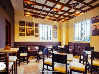 Cafetería El Gran Molino en Av. Colón: Restaurantes de estilo  por SXL ARQUITECTOS
