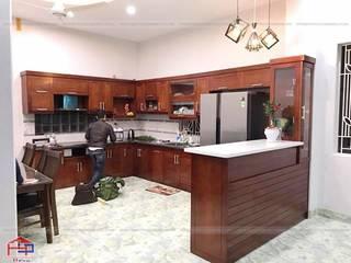 Tủ bếp gỗ xoan đào có quầy bar bếp sang trọng nhà anh Cường- Đông Anh Nội thất Hpro KitchenCabinets & shelves Wood effect