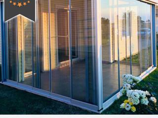 Jardines de invierno de estilo moderno de Albert Genau Moderno