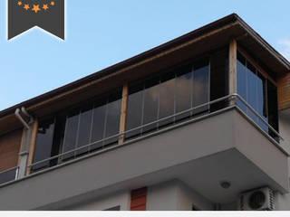 Balcones y terrazas de estilo moderno de Albert Genau Moderno