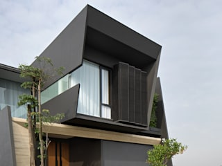 Single family home by Rakta Studio, Asian