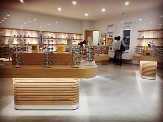 Óptica PH: Espacios comerciales de estilo  por Arquitectura CFA