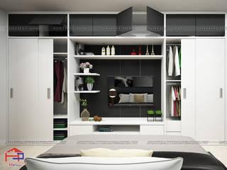 Công trình tủ bếp acrylic và nội thất gỗ công nghiệp An Cường nhà chị Ngọc ở Chùa Láng Nội thất Hpro BedroomWardrobes & closets Multicolored