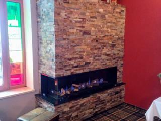 Kominki Miro-Les Foyers Ruang Keluarga Modern Batu Brown