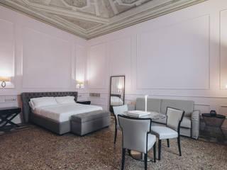 Dormitorios de estilo clásico de studio lenzi e associati Clásico