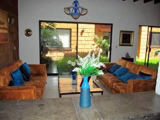 Diseño de una casa: Salas de estilo  por Alejandra Espinosa,