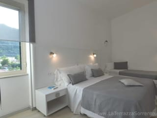 Hoteles de estilo  por La Terrazza Family House,