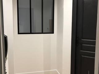 Appartement Bordeaux St Pierre: Couloir et hall d'entrée de style  par Intérieur Essentiel