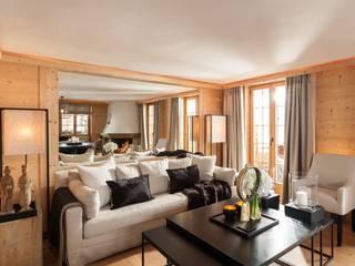 Wohnungsumbau in Chalet:  Wohnzimmer von RH-Design Innenausbau, Möbel und Küchenbau Aarau