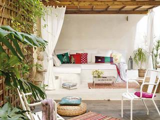Un oasis en medio de la ciudad de Barcelona Balcones y terrazas de estilo mediterráneo de Estudio Mireia Pla Mediterráneo