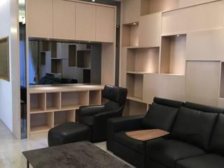 客廳造型櫃體:  客廳 by 心之所向設計美學工作室