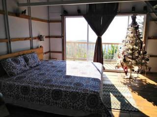 Villa Migelita ecolodge : Habitaciones de estilo  por Brand  Arquitecto interiorista paisajista,