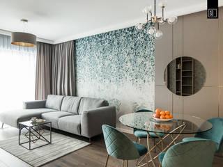 Salas de estilo  por KODO projekty i realizacje wnętrz, Moderno
