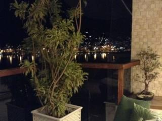 Cantinho da varanda: Varandas  por Guetta & Niquet Arquitetura