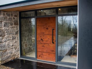 Oxidised metal entrance door by Camel Glass Modern