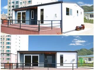 ห้องโถงทางเดินและบันไดสมัยใหม่ โดย 공간제작소(주) โมเดิร์น