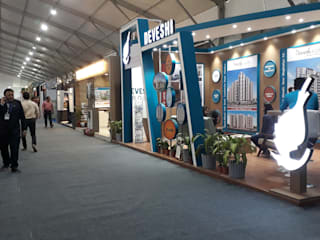 Booth of Devesh Group @ Credai Property Show 2019 by Inklets studio Modern
