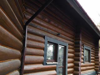 Бревенчатые дома в современном стиле.: Деревянные дома в . Автор – Ландшафтная Мастерская Ильи Лацис