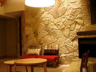Salas / recibidores de estilo  por Fabiana Ordoqui  Arquitectura y Diseño.   Rosario | Funes |Roldán, Rústico Piedra