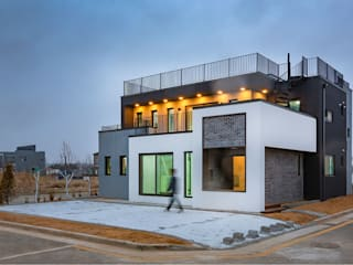 Country house by 한글주택(주), Modern