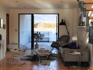 Edificio de viviendas y oficinas en Providencia Livings de estilo moderno de INFINISKI Moderno