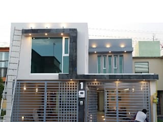 Houses by BAUS arquitectos, Modern