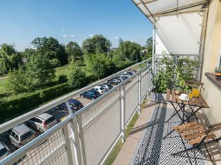 Home Staging na balkonie. Projekt balkonu od Miejskie Ziele Nowoczesny