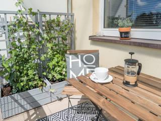 Home Staging na balkonie. Projekt balkonu: styl , w kategorii Balkon zaprojektowany przez Miejskie Ziele