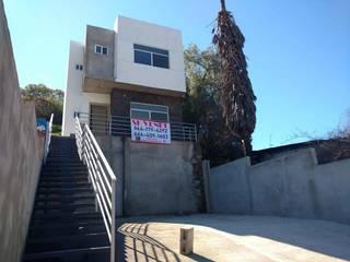 Casas nivel medio-residencial en Tijuana: Casas unifamiliares de estilo  por Studio DIEX: Construccion & Bienes Raíces