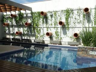 Casa KL: Piscinas  por Lara Arquitetura,Moderno