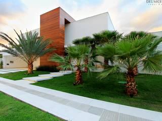Minimalist houses by Delmondes Arquitetura e Interiores Minimalist