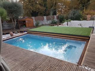 Terraza móvil motorizada para piscina: Piscinas de jardín de estilo  de AZENCO