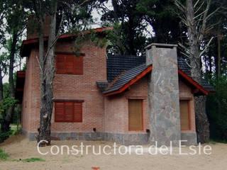 Casa Costa del Este/Dormitorio 1 Constructora del Este Casas unifamiliares Ladrillos