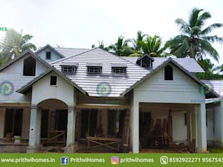 Leading house builders thrissur Asian style doors by Prithvi Homes Asian
