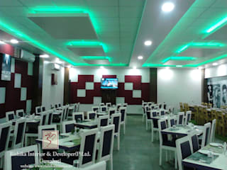seating arrangement:  Gastronomy by Rishika Interior & Developer (p) Ltd.