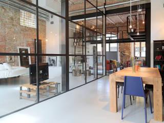 Comedores de estilo industrial de Soffici e Galgani Architetti Industrial
