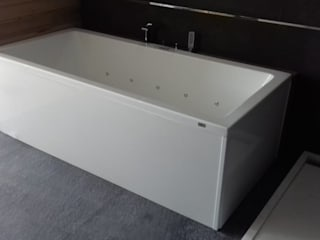Minimalistyczna łazienka od Designo Arquitectos Minimalistyczny