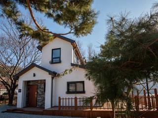홍천 루디아 하우스: (주)리움하우스의  주택