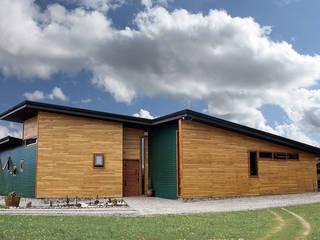 Casa Palote, Limache: Puertas de madera de estilo  por Intermedio Arquitectos