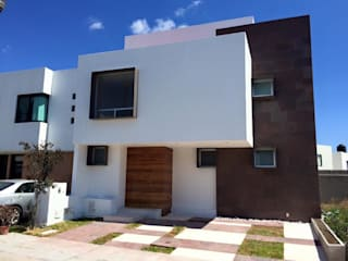 Casas unifamiliares de estilo  por LOGFE GRUPO DE ARQUITECTURA,