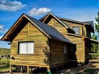 Construcciones de cabañas en tronco: Estadios de estilo  por Constructora Belaver