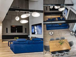 Parter domu na planie otwartym – salon z kominkiem SZARA / studio Nowoczesny salon Beton Szary