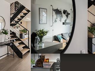 Wnętrze domu w bieli, grafice i drewnie – salon SZARA / studio Nowoczesny salon Drewno O efekcie drewna