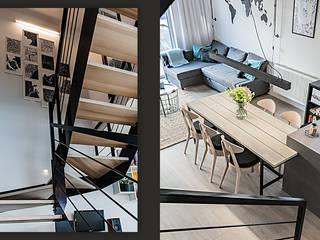 Wnętrze domu w bieli, grafice i drewnie – salon SZARA / studio Schody Drewno O efekcie drewna