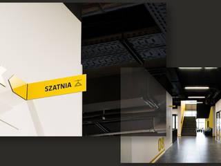 1500 m2 biurowca Marathon – projekt wnętrz siedziby firmy logistycznej SZARA / studio Przestrzenie biurowe i magazynowe Żółty