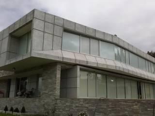 Brassea Mancilla Arquitectos, Santiago Casa unifamiliare Cemento armato Grigio