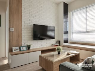 電視壁面造型:  客廳 by 顥岩空間設計
