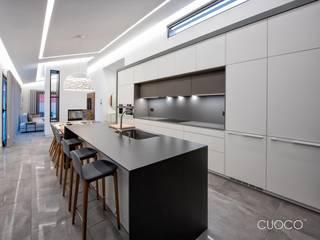 Vivienda Unifamiliar Cocinas de estilo moderno de CUOCO Moderno