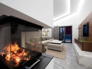 Vivienda Unifamiliar Salones de estilo moderno de CUOCO Moderno